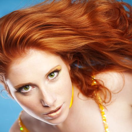 redheaded: Portrait of girl with beautiful red hair ob blue
