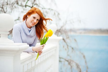 Beautiful girl with spring flowers photo