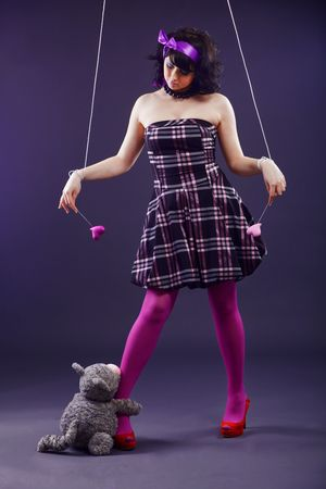 Beautiful woman stylized as mannequin marionette photo
