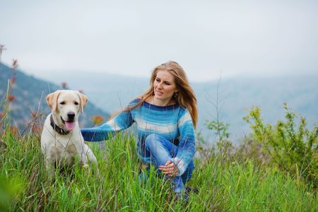 Girl with her dog resting outdoors photo