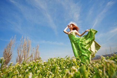 thin: Fashion model posing on meadow