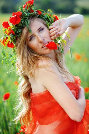 Closeup portrait of beautiful woman smelling flower Stock Photo - 4978673