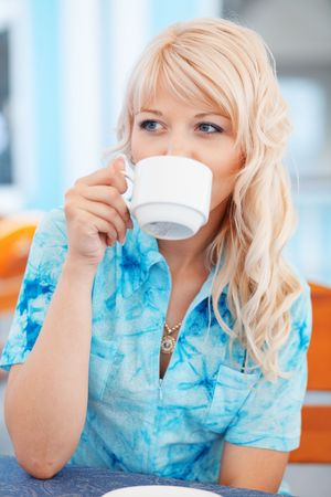 Pretty blonde drinking morning coffee in cafe Stock Photo - 5067185