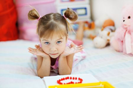 nursery room: Little girl playing with toys in her nursery Stock Photo
