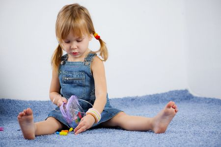 Cute child playing on carpet Stock Photo