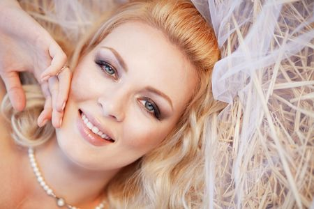 Closeup portrait of beautiful female with bridal makeup photo
