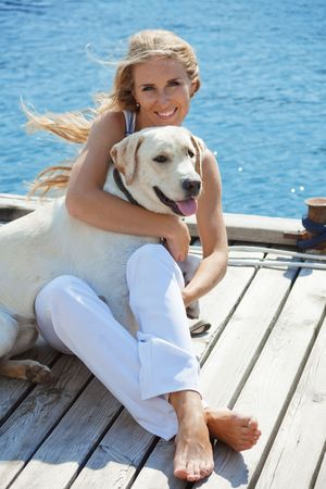 Portrait of young girl with her dog Stock Photo - 5524780