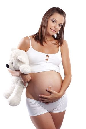 Happy smiling pregnant female isolated on white photo