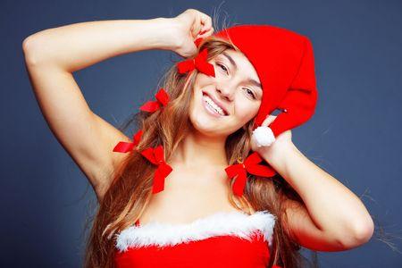 Beautiful cheerful Santa helper girl photo