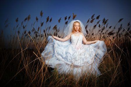 brushwood: Bride posing showing her wedding dress in rush brushwood