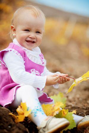 Portrait of little cute child in autumn Stock Photo - 5743737