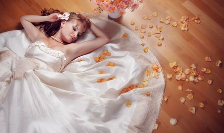 Portrait of beautiful bride lying on the floor Stock Photo