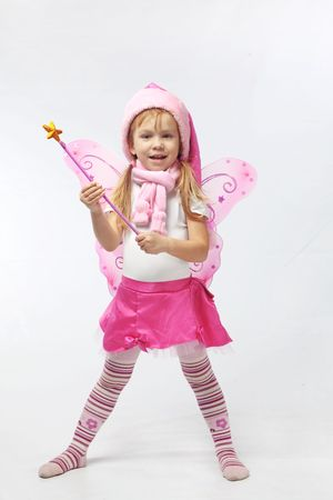 Portrait of sweet little girl in Christmas fairy costume photo