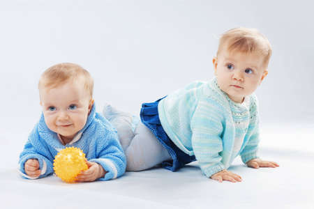 twin sister: Studio portrait of two little children twins