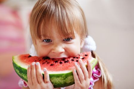 Fauuny child eating watermelon closeup Stock Photo - 5811022