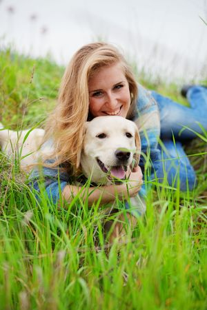 fondling: Girl with her dog resting outdoors