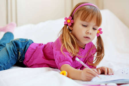 Little girl painting in her nursery at home Stock Photo - 5858070