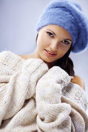 Portrait of beautiful young woman wearing fashion winter clothing photo