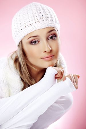 Close-up portrait of beautiful pure young woman wearing warm winter clothing photo