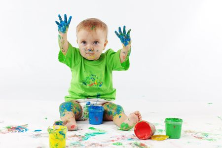 Funny baby painter on white background