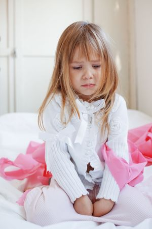 teen girl bedroom: Portrait of sad child girl