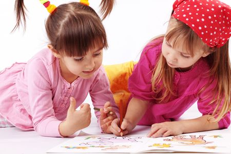 Portrait of cute kids drawing  over white photo