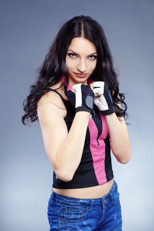 Portrait of young beautiful boxer woman photo