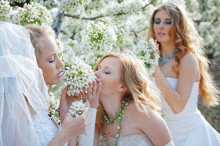 Three happy beautiful brides together photo