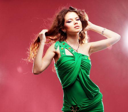 Fashion expressive girl dancing at disco light photo