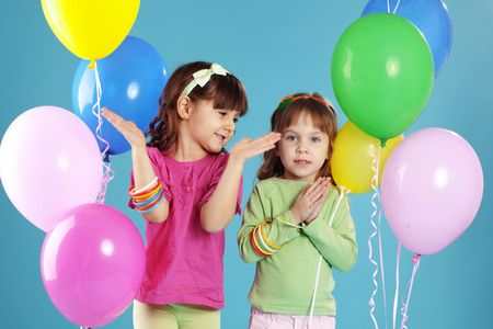 Happy children with colorful air ballons over blue Stock Photo - 6456782