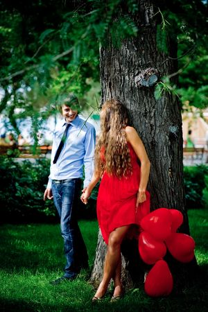 Young couple kissing in green park near tree Stock Photo - 6665912