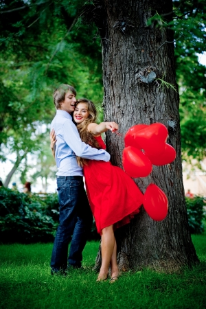 Young couple kissing in green park near tree Stock Photo - 6665917