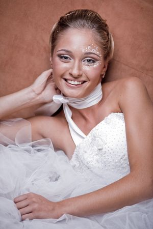 Fashion model with delicate make-up and face-art close-up Stock Photo - 6665857