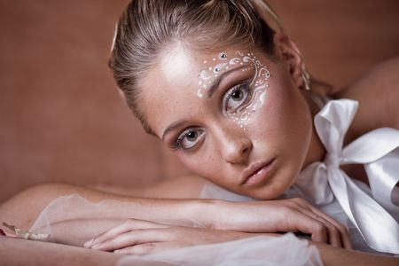 Fashion model with delicate make-up and face-art close-up Stock Photo - 6665855