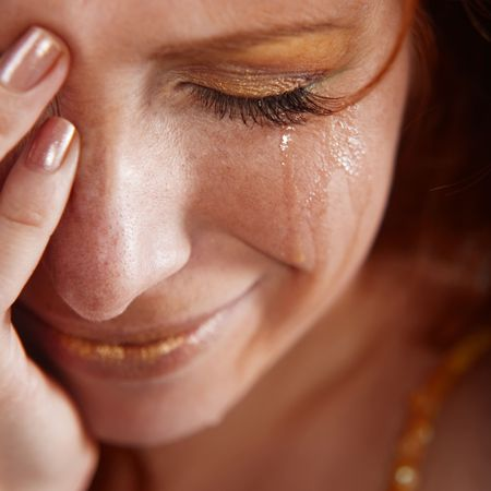 suffering: Closeup of crying woman with tears