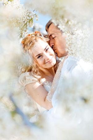Kissing wedding couple in spring nature close-up portrait Stock Photo - 6665712