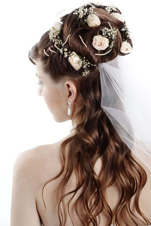 wedding hairstyle: Fashion bridal hairstyle with floral decoration