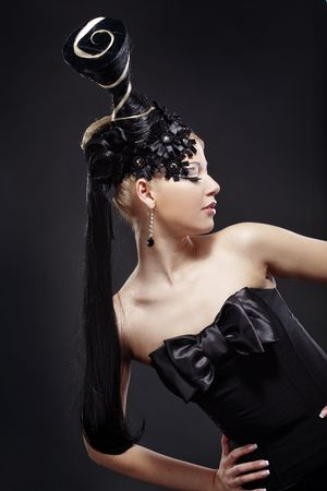 Portrait of stylish woman with fantasy hairstyle and make-up photo