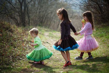 Three kid girls walking outdoors