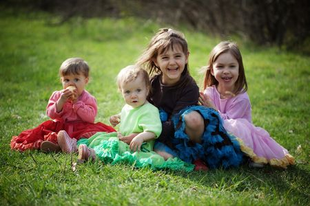 Group of happy kids outdoors Stock Photo
