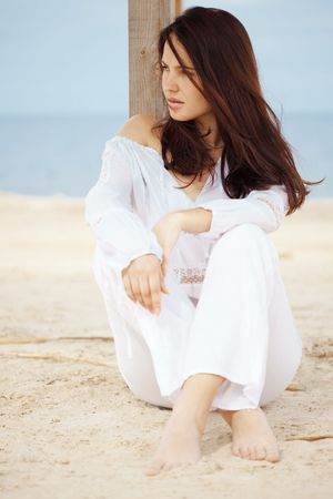Young woman resting at beach near the sea Stock Photo