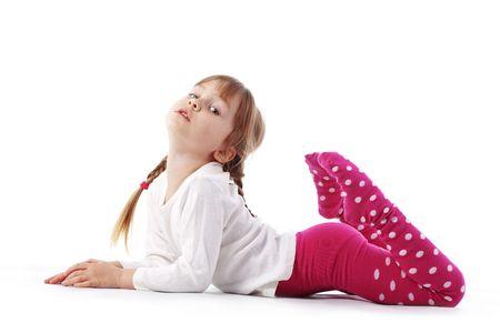Funny little girl posing over white photo