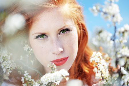 Portrait of beautiful redheaded girl in spring photo