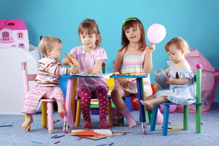 babies playing: Group of kids playing in the kindergarten Stock Photo