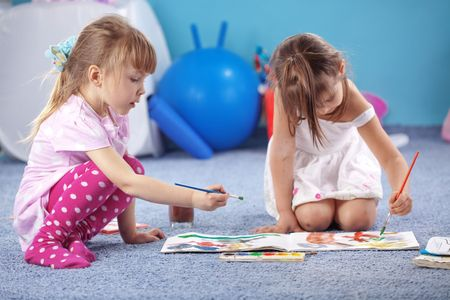 Children drawing in the nursery