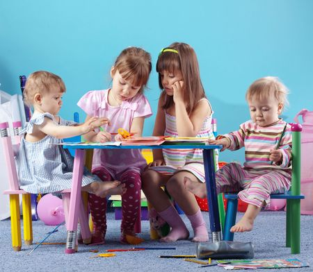 nursery education: Group of kids playing in the kindergarten Stock Photo