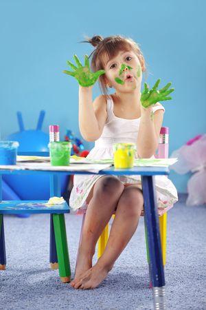 assiduous: Child painting in the kindergarten