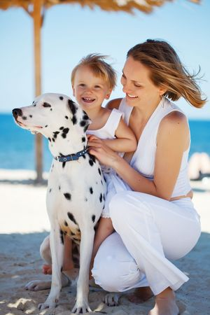 Happy family resting at beach in summer photo