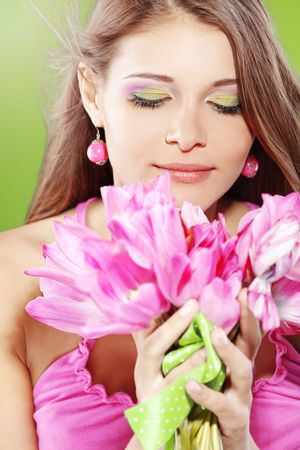 Beautiful girl with bunch of spring flowers photo