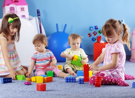 Group of kids playing with constructor photo